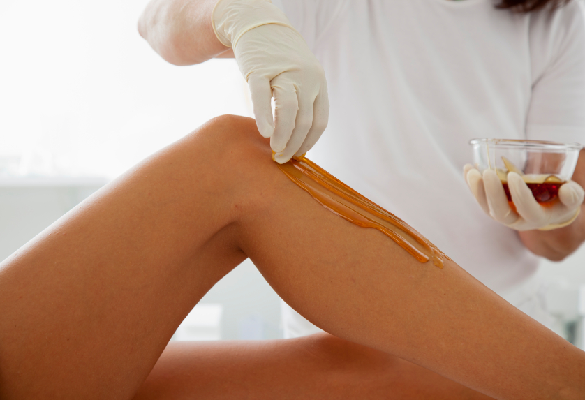 Woman Receiving a Waxing Treatment
